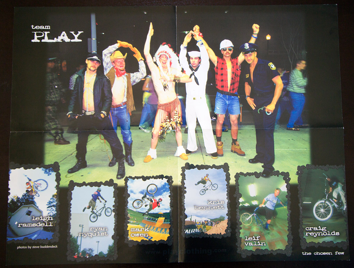 PLAY poster featuring the team dressed as the Village People, 1998