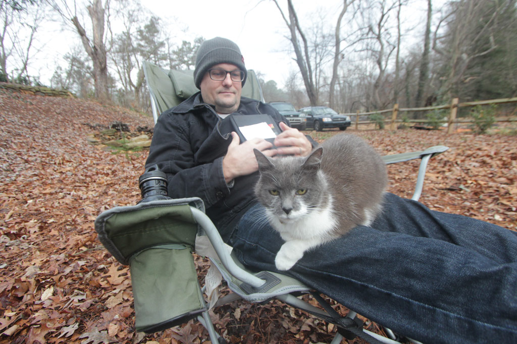 Scamper sitting on Leigh's lap in my backyard, Jan 2013