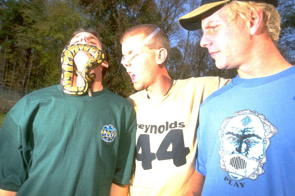 Leigh Ramsdell wearing the PLAY cookie jar tee while eating a snake. 1996