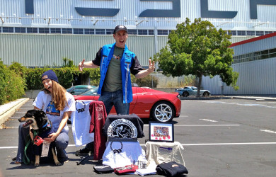 John Rokos posing with Jana & Arturo in front of the Tesla factory where he works with his