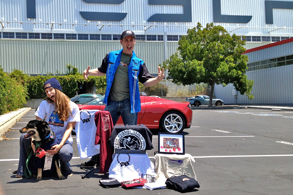 "John Rokos posing with Jana & Arturo in front of the Tesla factory (where he works) and sporting his ""Complete Everything"" package from Oldscool"